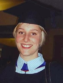 Head and shoulders profile of a young woman with blonde hair dressed in graduation gown and mortar board.