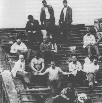 1990 Strangeways Prison riot - Prisoners protesting on the badly damaged roof of the prison. Paul Taylor is in the centre with his arms outstretched.