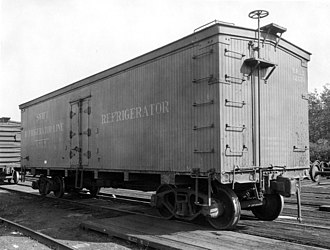 "Swift Refrigerator Line - A Swift refrigerated boxcar sits idle at East Orange, New Jersey. The car has been repainted to remove the original ""billboard"" advertising after such displays on freight cars were banned by the ICC in 1937."
