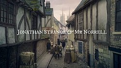 Series title over a 19th century street scene