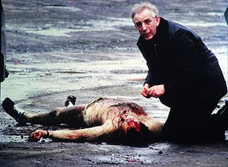 Corporals killings - Father Alec Reid administers the last rites to Corporal David Howes.