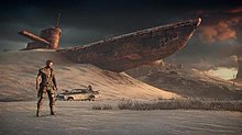 Screenshot of Max, the Magnum Opus and a large ship half-buried in sand