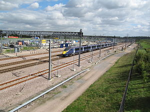 Singlewell Infrastructure Maintenance Depot - Depot being passed by a Southeastern Class 395 train at speed.