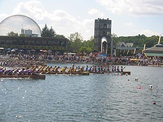 War canoe - Junior Women's War Canoes (C-15) come across the line at the 2005 Canadian Canoe Association Championships, held at le bassin olympique in Montreal, Quebec, Canada.