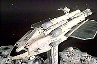 The image depicts a futuristic spaceship docked to a structure that represents part of a space station.