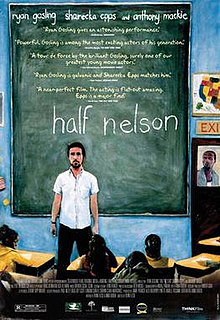"A man standing in front of a blackboard, the words ""half nelson"" written prominently in white chalk."