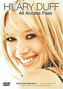 "The face of a young, smiling blonde girl with brown eyes. At the top of her image, ""Hilary Duff"" is written in black capital letters with ""All Access Pass"" written in black below that. At the bottom of her image, ""met-a-mor-pho-sis"" is written in black bold font, followed by the text ""n. 1. The transformation from actress to music phenomenon"" in black italic font."