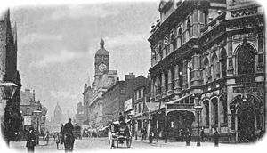 Stanley Kirkby - Oxford Road, Manchester, c. 1900 – with the Palace Theatre (foreground right) and St. James's Hall beyond (with clock tower).