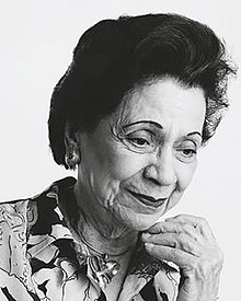 Black and white portrait of a woman in white background