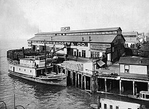 Pier 54, Seattle - Pier 54 (then Pier 3) circa 1901, with steamer T.W. Lake alongside.