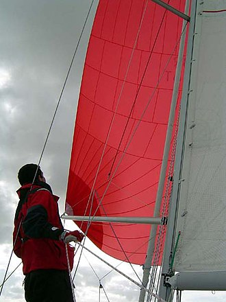 Spinnaker pole - A spinnaker pole being used to set a conventional symmetric spinnaker