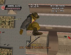 A dark-skinned man wearing a fedora and heavy jacket performs a skate trick about fifty feet above a halfpipe, having built up momentum by skating in it. Russian military tanks and a few people are standing off to the sidelines.