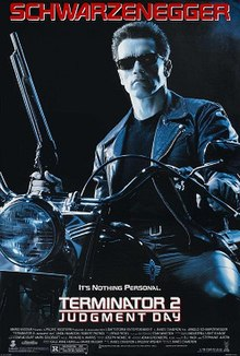 "Theatrical release poster of film of man sitting on motorbike, wearing black glasses and clothing, holding shotgun almost vertically. Above his head is the capitalised word ""Schwarzenegger""; below him is the film's name"