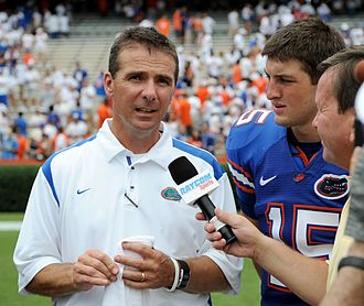 2008 Florida Gators football team - Florida Gators coach Urban Meyer and quarterback Tim Tebow being interviewed following the Gators' victory.