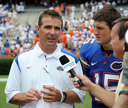 Urban Meyer (left) and Tim Tebow after a win on opening day. Urban Meyer UFvshawaii2008.jpg