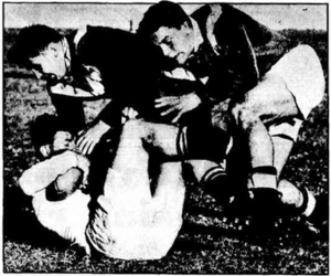 1951 French rugby league tour of Australia and New Zealand - Brisbane forward Bill Sims being tackled by French forwards Andrew Deraud and Guy Delaye.