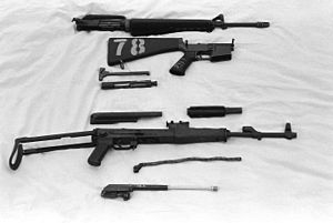 AKM - The AKMS variant field stripped (below) compared to the American M16