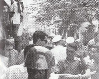Double Seven Day scuffle - The aftermath of the altercation. David Halberstam (center, wearing sunglasses) repels plainclothes policemen after their attack on Peter Arnett (far left).