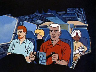 """Jonny Quest (TV series) - The Quest team. Front row (left to right): Dr. Benton Quest and """"Race"""" Bannon. Back row: Jonny Quest, Hadji, and Bandit"""