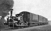 Small locomotive hauls four coaches of various designs