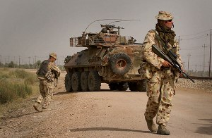Al Muthanna Task Group - Australian soldiers supported by an ASLAV-25 patrol along a railway line near Camp Smitty during routine foot patrols in Al Muthanna Province
