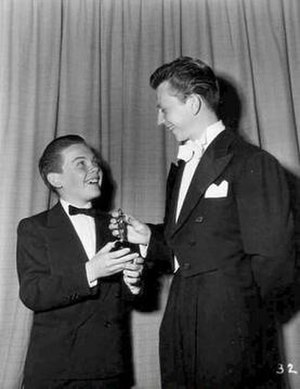 Academy Juvenile Award - Bobby Driscoll accepting the Juvenile Award