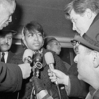 Betty Shabazz - Betty Shabazz in February 1965, after identifying Malcolm X's body at the New York City Morgue