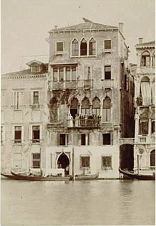 Victorian photograph of a Venetian palazzo with a group of people on the main balcony
