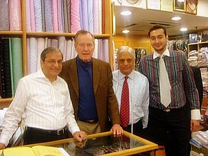 Sam's Tailor - Left to right - Sham, George Bush Senior, Manu and Roshan inside the store