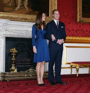 Engagement announcement dress of Catherine Middleton - A full-body view of Catherine Middleton (left) in the blue Issa dress she wore at her engagement announcement to Prince William of Wales (right) at St. James's Palace.