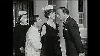 Norman Wisdom -  Wisdom (second from left) in a confrontation with Jerry Desmonde (far right) from ''A Stitch in Time'' (1963)