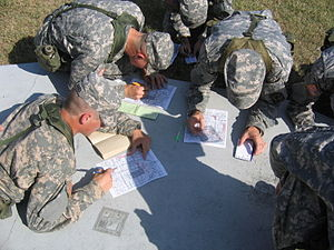 University of Oklahoma Army ROTC - Cadets preparing their maps for an orienteering course on a field training exercise (FTX).