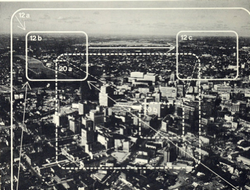 Photograph of downtown Rochester shows two of the scene plots used in the film: a zoom to horizon and pan across, and a street-corner zoom from medium close-up. Verticals, diagonal pans, up-zooms and other combinations were used to abstract several scenes from a few 4X5 color transparencies taken by aerial photographer---effectively simulating smooth helicopter and aircraft cinematography at a fraction of the cost.