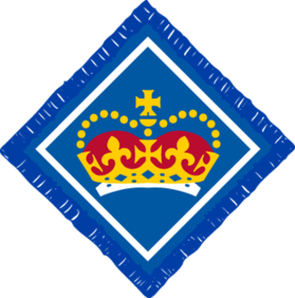 Queen's Scout - The current badge of the UK Queen's Scout Award, as worn on the uniform of award recipients