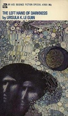 Front cover of the first edition, with art by the Dillons. Cover depicts two faces against an abstract background.