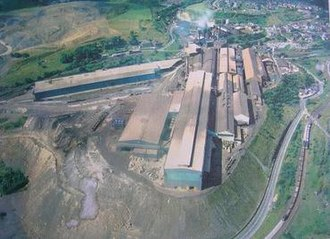Brymbo - The older parts of Brymbo Steelworks in the 1970s, showing its restricted hillside site, with the melting shop (centre) and blast furnace (top) next to the village (top right). The banks shown in the foreground had covered most of the former village of Lodge.