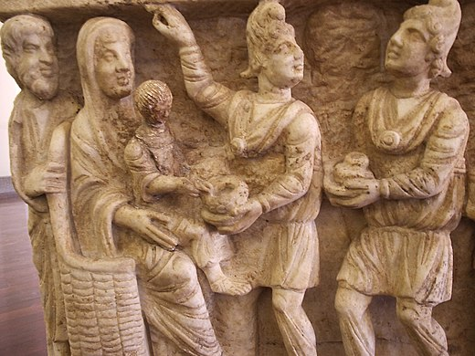 One of the earliest known depictions from a third-century sarcophagus (Vatican Museums). The clothing of the Magi here is typical of Parthian nobles. Early Christian Magi.JPG