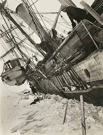 Endurance (1912 ship) - Shackleton looking overboard at Endurance being crushed by the ice