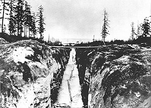 Montlake Cut - This log sluice connecting Portage Bay to Lake Washington pre-dates the Montlake Cut; seen here in 1886.