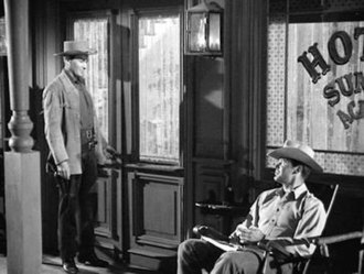 Shady Deal at Sunny Acres - Brothers Bart (Jack Kelly) and Bret Maverick (James Garner) exchanging glances at the Hotel Sunny Acres.