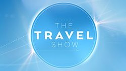 """The Travel Show"" lettering within a blue circle"