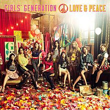 The cover art for the album. It portrays the girl group sitting, standing, or leaning against something in the corner of an art studio with paper flowers scattered on the floor. The peace symbol is plastered a few times on the image.