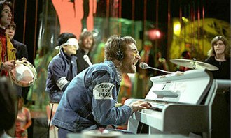 Instant Karma! - Lennon and Ono (wearing a white blindfold) performing the song on Top of the Pops in February 1970