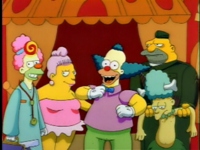 Krusty finishes his show with a song.