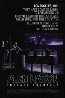 "A black poster. Above in bold letters are the lines: ""Los Angeles, 1991."" ""They have come to earth to live among us."" ""They've learned the language."" ""Taken jobs."" ""And tried to fit in."" ""But there's something about them we don't know."" Below, in large typeface is the line: ""Alien Nation"" and in smaller typeface, the line: ""Prepare Yourself,"" with the film credits underneath. In the background are three extraterrestrials standing on a street corner. One of the figures is a female standing next to a waste basket and three newspaper stands, holding a jacket over her shoulders. Behind her is a bar that features alien typography on its walls. Two extraterrestrials who are hanging out inside the bar, can be seen through its glass window."