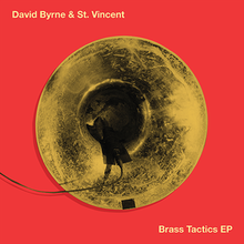 "A piece of recording equipment hanging out of a brass horn on an orange background with ""David Byrne & St. Vincent"" and ""Brass Tactics"" written in yellow"