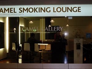 A Camel Cigarette Smoking Room in an airport a...