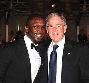 Darey - Darey with U.S. President George W. Bush while hosting the ThisDay Awards in Abuja, Nigeria