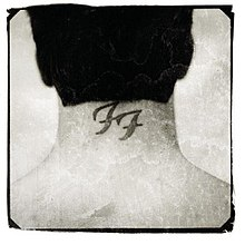 Black and white photograph of the back of Dave Grohls head A tattoo of the Foo Fighters logo is seen on his neck