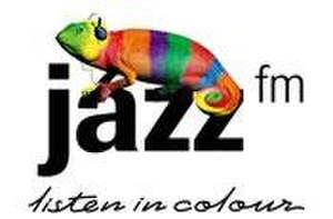 "102.2 Jazz FM - The Jazz FM logo in use until the end of 2002. Also illustrated is the Jazz FM chameleon and the ""Listen in Colour"" branding."